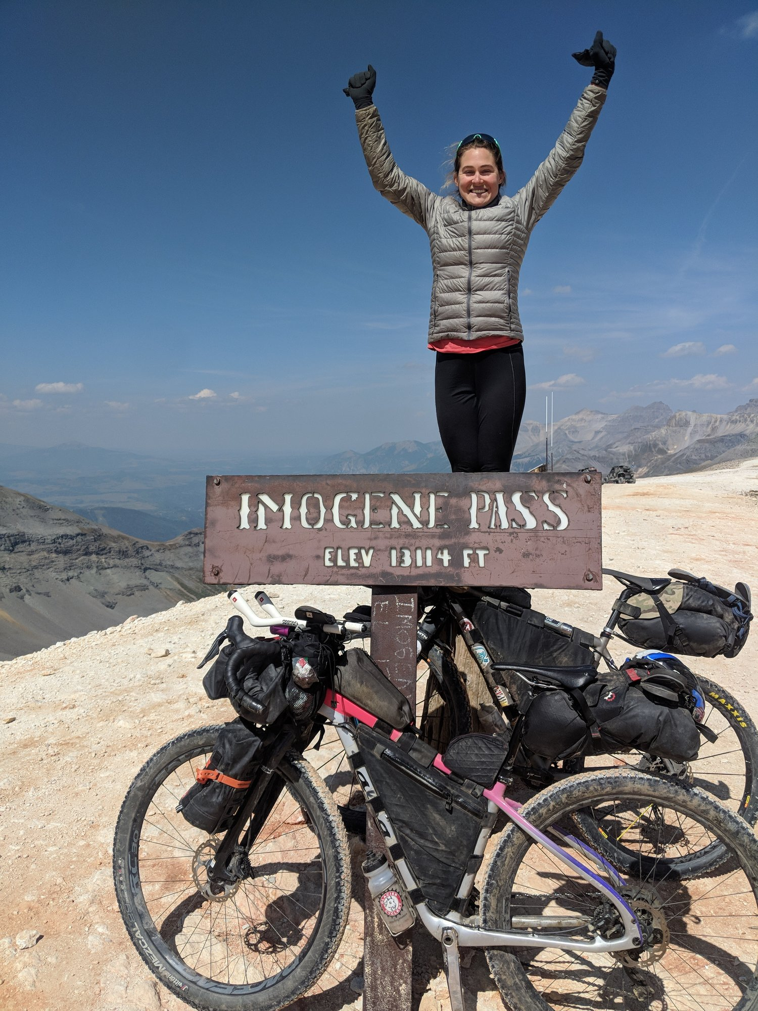 Caitlin in her victory pose on Imogene Pass